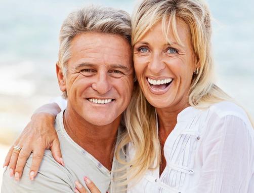 couple smiling after receiving platelet-rich-plasma treatment