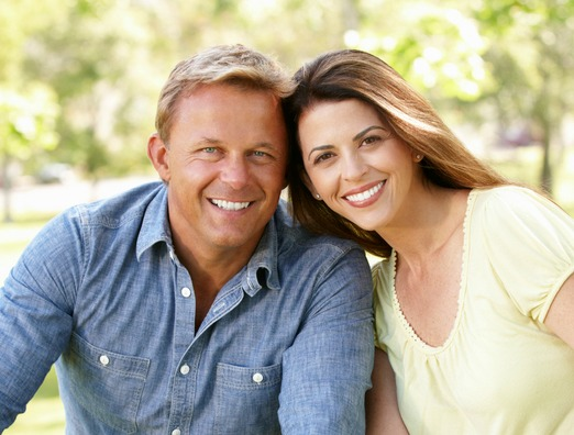 couple smiling after receiving oral pathology in richmond indiana