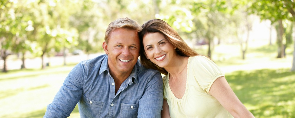 couple smiling after getting oral pathology in richmond indiana
