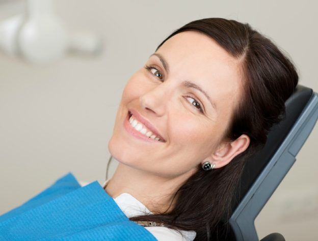 woman smiling while waiting for wisdom teeth removal in richmond indiana